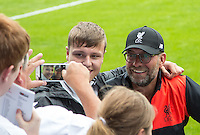 Liverpool Manager Jurgen Klopp poses for photos with supporters during the 2016/17 Pre Season Friendly match between Tranmere Rovers and Liverpool at Prenton Park, Birkenhead, England on 8 July 2016. Photo by PRiME Media Images.