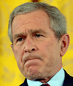 Washington, D.C. - February 14, 2007 -- United States President George W. Bush speaks to the media during a news conference in the East Room of the White House on Wednesday, February 14, 2007.  <br /> Credit: Roger L. Wollenberg - Pool via CNP