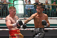 Brandon Ball (black shorts) defeats Robbie Forster during a Boxing Show at York Hall on 8th June 2019