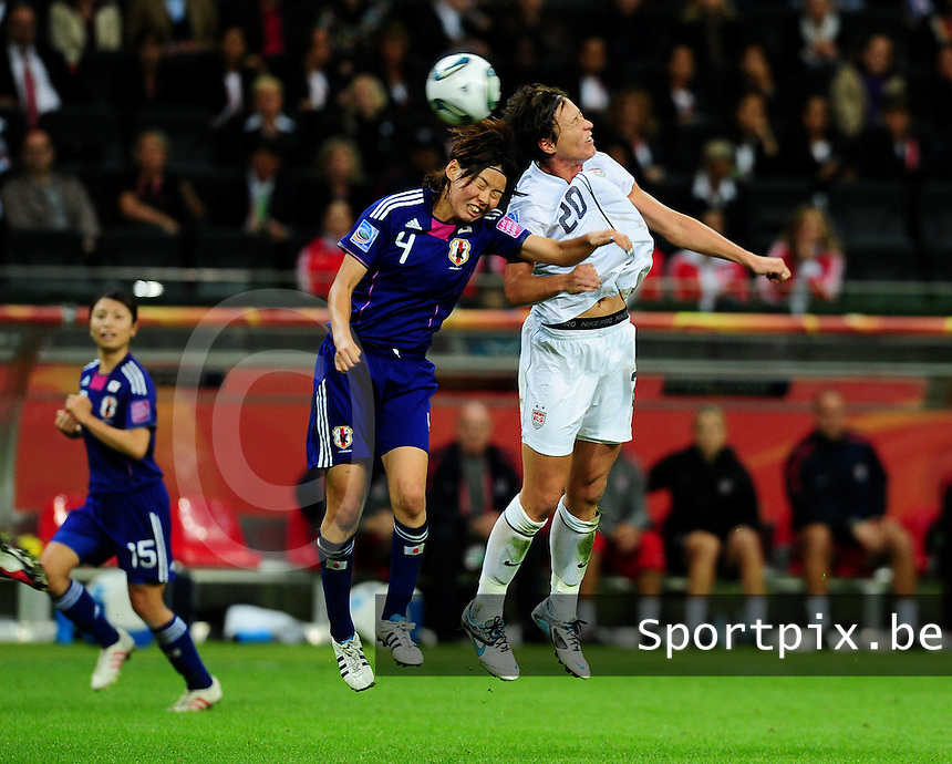 Fifa Women's World Cup Germany 2011 : Japan - USA  at Commerzbank Arena Frankfurt : Saki Kumagai in duel met Abby Wambach.foto DAVID CATRY / Vrouwenteam.be