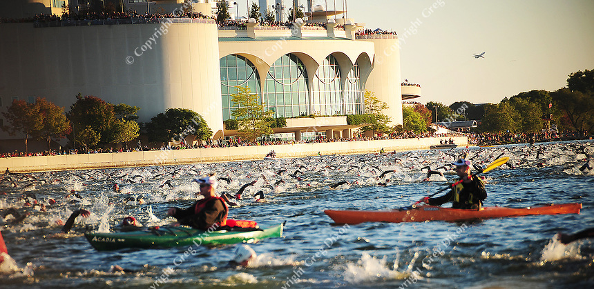 Swimmers pass in front of Monona Terrace during Ironman 2010 on Sunday, 9/12/10, in Madison, Wisconsin