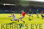 Pa Warren, East Kerry has his shot at goal blocked by Eoghan O'Brien, St Brendans  during the Semi finals of the Kerry Senior GAA Football Championship between East Kerry and Saint Brendans at Fitzgerald Stadium on Sunday.