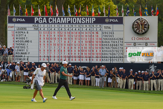 Brooks Koepka (USA) walks past the scoreboard on his way to the green on 18 during 4th round of the 100th PGA Championship at Bellerive Country Club, St. Louis, Missouri. 8/12/2018.<br /> Picture: Golffile   Ken Murray<br /> <br /> All photo usage must carry mandatory copyright credit (© Golffile   Ken Murray)