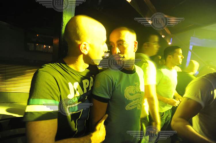 "Men in a nightclub in Tel Aviv where the gay chatline ""Big Boys"" is holding a party."