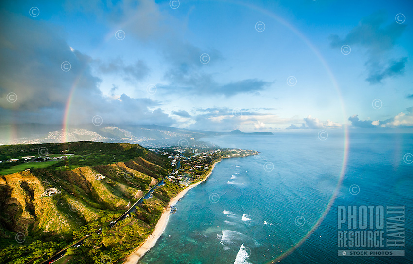 An aerial perspective of a massive full rainbow at Diamond Head, Honolulu, O'ahu.