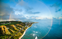 An aerial perspective of a massive full rainbow at Diamond Head, Honolulu, O'ahu.