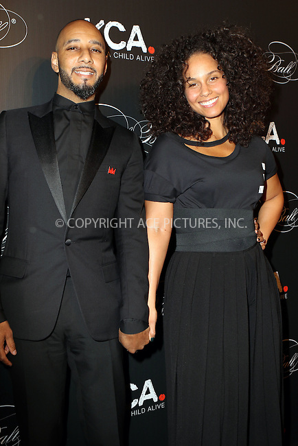 www.acepixs.com<br /> <br /> October 19 2016, New York City<br /> <br /> Swizz Beatz (L) and Keep A Child Alive co-founder Alicia Keys arriving at the Keep A Child Alive's Black Ball 2016 at the Hammerstein Ballroom on October 19, 2016 in New York City.<br /> By Line: Nancy Rivera/ACE Pictures<br /> <br /> <br /> ACE Pictures Inc<br /> Tel: 6467670430<br /> Email: info@acepixs.com<br /> www.acepixs.com