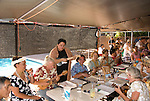 Hawaii: Molokai, Friday night kupuna night  entertainment by locals at the Hotel Molokai, with singers, ukulele strummers, hula dancers, and good food and drink. .Photo himolo173-71776..Photo copyright Lee Foster, www.fostertravel.com, lee@fostertravel.com, 510-549-2202