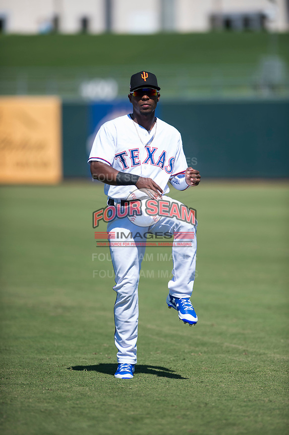 Surprise Saguaros outfielder Julio Pablo Martinez (40), of the Texas Rangers organization, before an Arizona Fall League game against the Salt River Rafters on October 9, 2018 at Surprise Stadium in Surprise, Arizona. Salt River defeated Surprise 10-8. (Zachary Lucy/Four Seam Images)
