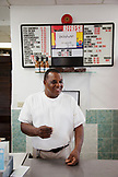 BERMUDA. St. George. Art Mel in his restaurant called Art Me's Spicy Dicy, known for his fish sandwich.