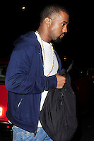 NON EXCLUSIVE PICTURE: MATRIXPICTURES.CO.UK.PLEASE CREDIT ALL USES..WORLD RIGHTS..American hip hop rapper Kanye West is pictured arriving at the London hotel of his girlfriend, reality TV star Kim Kardashian, at 3am...It follows a late night session at a recording studio...NOVEMBER 8th 2012..REF: ASI 125157