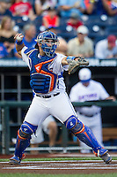 Florida Gators catcher Mike Rivera (4) throws the ball to second base against the Miami Hurricanes in the NCAA College World Series on June 13, 2015 at TD Ameritrade Park in Omaha, Nebraska. Florida defeated Miami 15-3. (Andrew Woolley/Four Seam Images)