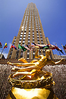 Prometeus golden sculpture at The Rockefeller Center and skyscraper in New York City, USA