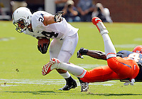 Penn State running back Derek Day (24) avoids a tackle by Virginia fullback Sammy MacFarlane (44) during an NCAA college football game in Charlottesville, Va. Virginia defeated Penn State 17-16.