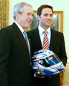 United States President George W. Bush participates in a Photo Opportunity with Jimmie Johnson, the 2006 NASCAR Nextel Cup Champion, in the Oval Office at the White House in Washington, D.C. on Monday, February 5, 2007.<br /> Credit: Ron Sachs / Pool