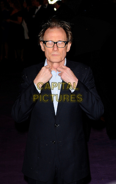 "BILL NIGHY.The World Premiere of ""The Young Victoria"" at the Odeon Leicester Square, London, England. .March 3rd 2009 .half length black blue suit jacket hands glasses eyes closed funny face shirt.CAP/CAN.©Can Nguyen/Capital Pictures."
