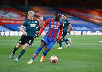 29th June 2020; Selhurst Park, London, England; English Premier League Football, Crystal Palace versus Burnley Football Club; Cheikhou Kouyate of Crystal Palace on the ball with Ben Mee of Burnley marking