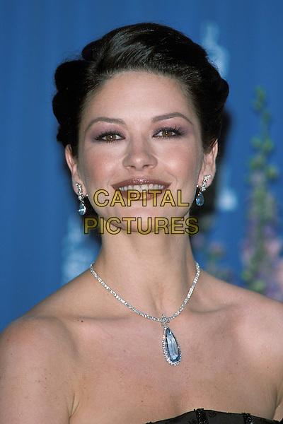 CATHERINE ZETA JONES.Ref : 10754.diamond brooch necklace, headshot, portrait, bare shoulders.www.capitalpictures.com.sales@capitalpictures.com.©Capital Pictures