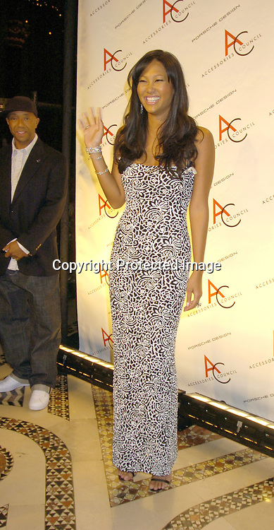 Russell Simmons and wife Kimora Lee Simmons ..Kimora Lee Simmons ..at The Accessories Council 8th Annual ACE Awards on ..November 1, 2004 at Cipriani 42nd Street. ..Photo by Robin Platzer, Twin Images