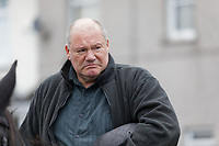 Pictured: Byron John outside St John Lloyd School, in Llanelli, Carmarthenshire, UK. Thursday 12 September 2019<br /> Re: The family of a bullied pupil were joined by friends and held a minute's silence, a year after he hanged himself in school toilets.<br /> His heartbroken father Byron John claims his son Bradley, 14, would still be alive if the school had acted to stop the bullies.<br /> Bradley's 13-year-old sister Danielle found him dead in the toilet block at, an hour after going missing at St John Lloyd Roman Catholic School in Llanelli, South Wales, UK.