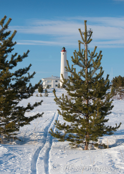 Marjaniemi Lighthouse in early April. It is photographically challenging to hide the ugly radar mast as it is placed so close to the Lighthouse on Hailuoto Island, Gulf of Bothnia, Finland.
