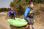 April 30, 2012. Charlotte, NC.. Erik Weihenmayer, left, and Rob Raker, who will be accompanying Erik on the river, head back to the top of the whitewater course to try it again.. Erik Weihenmayer, who has been completely blind since age 13, is training at the United States National White Water Center in an attempt to kayak through the Grand Canyon. Weihenmayer is an accomplished outdoorsman who has climbed the 7 Summits, and is the only blind person to climb Mount Everest.