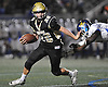 Tommy Rohan #20 of Wantagh picks up ground yards during the Nassau County varsity football Conference III final against Roosevelt at Hofstra University on Friday, Nov. 18, 2016. Wantagh won by a score of 13-0.