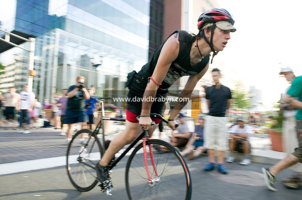 "3 July 2005 - Jersey City, NJ, USA - A rider competes in the skids event, which requires bikers to cover the greatest possible distance with a non-moving back wheel, at the 13th annual cycle messenger world championships, Jersey City, USA, July 2nd 2005.  A new world record of 509 feet was set on this occasion by Gerardo Atilano, aka ""Squirrel"", from Houston, TX. More than 700 riders from all over the world took part in the 4-day competition which carries event based on the daily work of a city bike messenger."