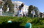 A young participant rolls eggs during the White House Easter Egg Roll on the South Lawn of the White House March 28, 2016 in Washington, DC. <br /> Credit: Olivier Douliery / Pool via CNP