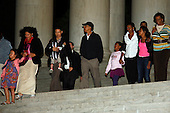 Washington, DC - September 27, 2009 -- United States President Barack Obama and family descend the steps of the Jefferson Memorial in Washington, DC, following a brief, unscheduled visit to the memorial Sunday evening, September 27, 2009. Shown left to right are Suhaila Ng, Maya Soetoro-Ng (the president's sister), Konrad Ng (holding baby Sevita), the president, Sasha Obama, Michelle Obama, Malia Obama, and the president's mother-in-law Marian Robinson.  Credit: Martin H. Simon / Pool via CNP
