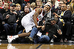 12/26/11--Trail Blazers center Marcus Canby flies into the baseline for a loose ball in the home-opener against the Philadelphia 76ers at the Rose Garden...Photo by Jaime Valdez. .........................................