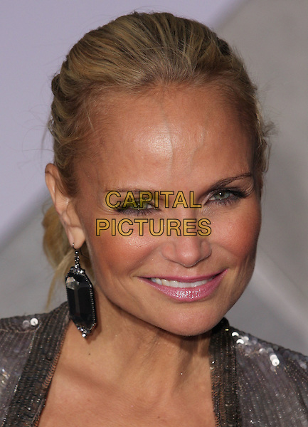 "KRISTIN CHENOWETH .""When In Rome"" Los Angeles Premiere - Arrivals held at The El Capitan Theater, Hollywood, CA, USA, .27th January 2010..portrait headshot hair up silver sequined sequin earrings dangly  smiling tanned sun tan.CAP/ADM/CH.©Charles Harris/AdMedia/Capital Pictures"