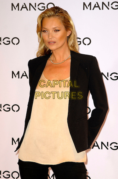 Kate Moss.photocall for the new face of the Mango for Spring/Summer print and television 2012 campaign. Mango, Oxford Street, London, England.24th January 2012.half length black black jacket nude cream top necklace .CAP/CAS.©Bob Cass/Capital Pictures.