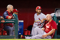 Matt Holliday (7) of the St. Louis Cardinals, Daniel Descalso (33), and Skip Schumaker (55) sit in the dugout during a game against the Springfield Cardinals at Hammons Field on April 2, 2012 in Springfield, Missouri. (David Welker/Four Seam Images)