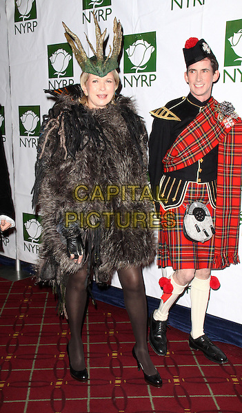 MARTHA STEWART .Bette Midler's New York Restoration Project Annual Hulaween Gala held at the Waldorf-Astoria Hotel,New York, NY, USA, 30th October 2009..Halloween costume dressed-up full length coat tights brown fur furry fluffy headdress hat sticks green sticks twigs .CAP/ADM/PZ.©Paul Zimmerman/Admedia/Capital Pictures