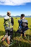 USA, Alaska, Homer, hikers photograph a grizzly (brown) bear, Katmai National Park, Katmai Peninsula, Hallow Bay, Gulf of Alaska