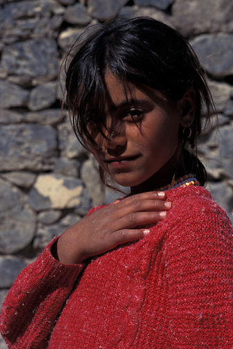 Pinar poses for her portrait outside her Kanikurk village home near Mt. Ararat in Southeast Turkey. (Photo © September 1996 Pico van Houtryve)