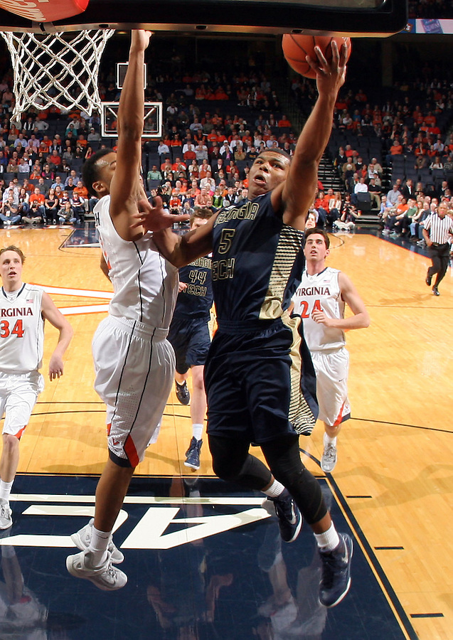 Georgia Tech guard Corey Heyward (5) shoots next to Virginia guard B.J. Stith (2) during an NCAA basketball game Thursday Jan. 22, 2015, in Charlottesville, Va. Virginia defeated Georgia Tech 57-28. (Photo/Andrew Shurtleff)