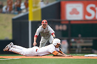 Shortstop Caleb Bushyhead #5 of the Oklahoma Sooners lunges to tag out the runner in the 9th inning against the Texas Longhorns in NCAA Big XII baseball on May 1, 2011 at Disch Falk Field in Austin, Texas. (Photo by Andrew Woolley / Four Seam Images)