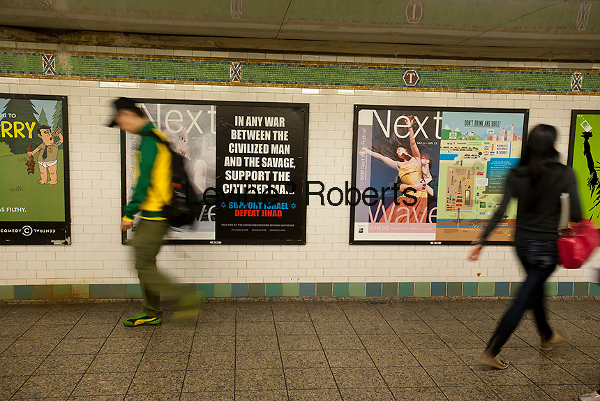 An advertisement in the subway in New York supports Israel and promotes defeating Jihad, referring to Jihadists as savages, is seen in the Times Square subway station on Monday, September 24, 2012. The controversial poster is from the American Freedom Defense Initiative, a group run by Pamela Geller who also runs the Stop Islamization of America group. (© Richard B. Levine)