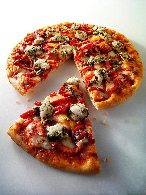 Pizza topped with pesto  chicken and red peppers photos. Funky Stock pizzas photos