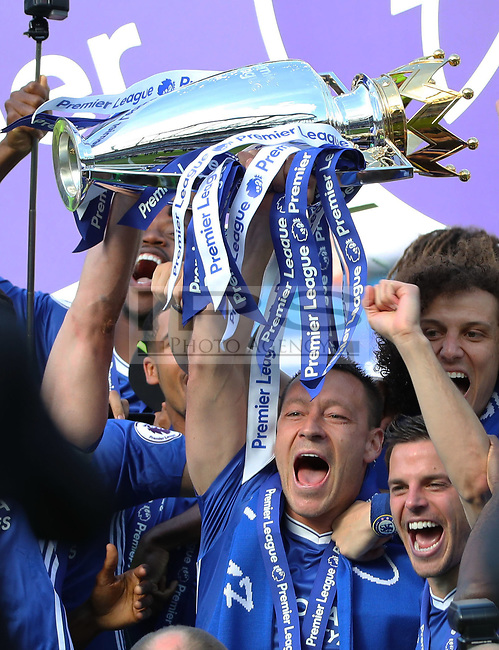 John Terry of Chelsea  lifts the trophy after the Premier League match between Chelsea v Sunderland, Stamford Bridge, London on 21st May 2017