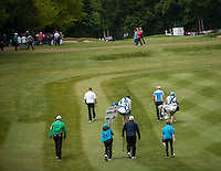 24.05.2015. Wentworth, England. BMW PGA Golf Championship. Final Round.  Thomas Bjorn [DEN] and Martin Kaymer [GER] make their way down the first fairway during the final round of the 2015 BMW PGA Championship from The West Course Wentworth Golf Club