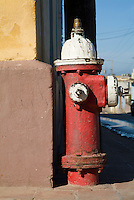 Run down red fire hydrant on a street corner in Trinidad, Cuba.