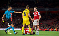 Kieran Tierney confronts Mergim Vojvoda of Standard Liege as Gabriel Martinelli of Arsenal lays injured during the UEFA Europa League match between Arsenal and Standard Liege at the Emirates Stadium, London, England on 3 October 2019. Photo by Andrew Aleks.