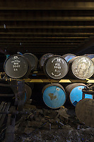 Single malt Scotch Whisky in oak casks - barrels - in traditional dunnage warehouse during maturation process at Talisker Distillery in Isle of Skye, Scotland