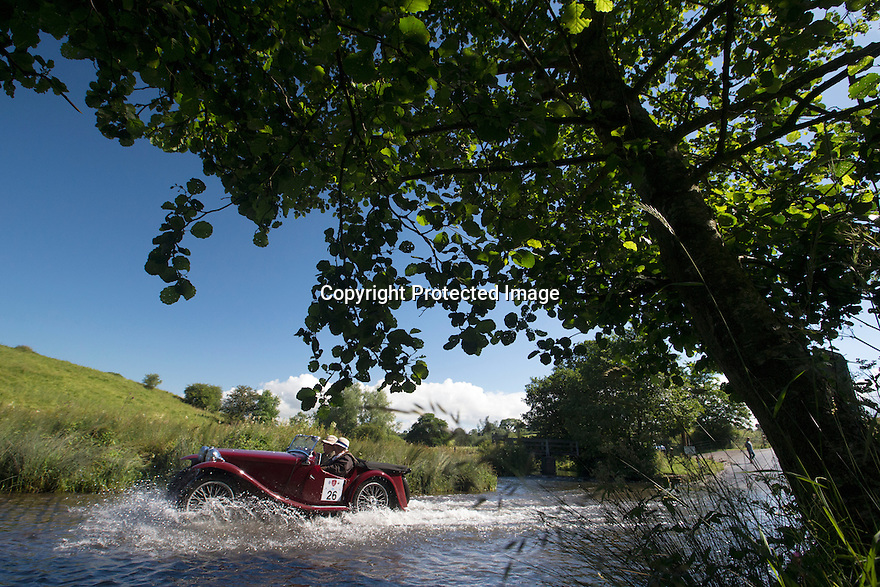 14/06/16<br /> <br /> Steve and Julia Robertson in their 1936 MG PB.<br /> <br /> Competitors in the Royal Automobile Club 1000 Mile Trial splash through Tissington Ford near Ashbourne in the Derbyshire Peak District. The rally saw 43 pre-war cars leave Edinburgh on Monday and finishes in Dorking, Surrey on Saturday.<br /> All Rights Reserved, F Stop Press Ltd.