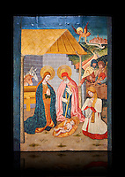 Gothic altarpiece ofthe Nativity from the workshop of Taller de Pere Garcia de Benavarri, circa 1475, tempera and gold leaf on for wood, from the church of Nostra Senyora de Baldos de Montanyana, Osca.  National Museum of Catalan Art, Barcelona, Spain, inv no: MNAC   114750-1. Against a black background.