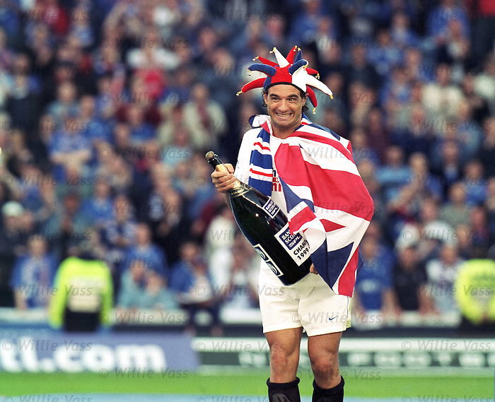 Lorenzo Amoruso with a big bottle of Champions Champagne in the Ibrox cenre circle, April 2000