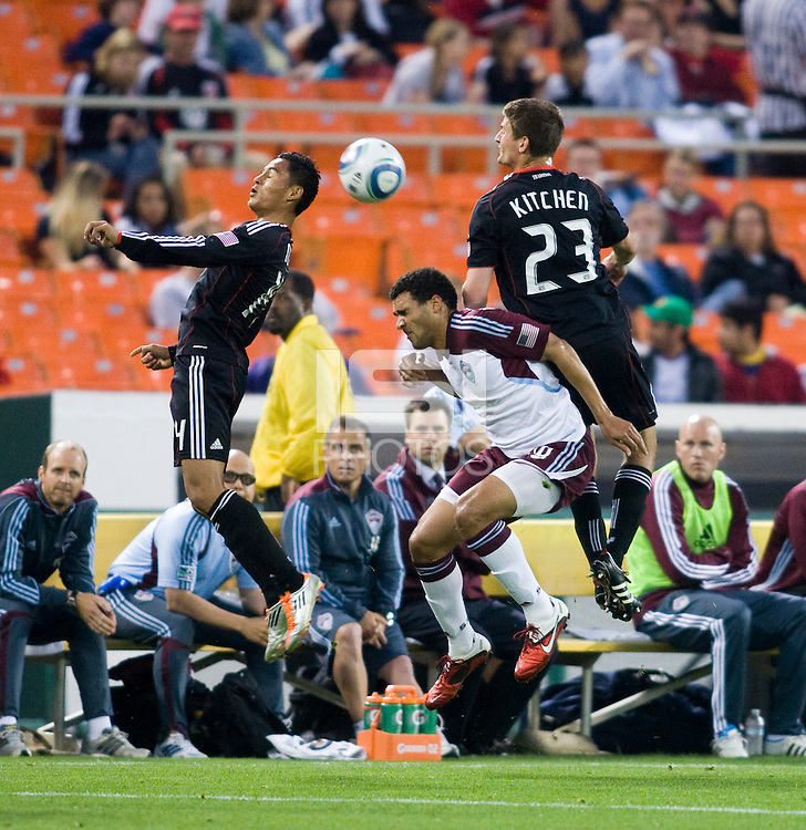 Andy Najar (14) and Perry Kitchen (23) of D.C. United go up for a header with Andre Akpan (19) of the Colorado Rapids during the game at RFK Stadium in Washington, DC.  D.C. United tied the Colorado Rapids, 1-1.